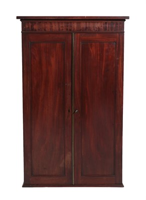 Lot 65 - A Mahogany Wall Cabinet, 2nd quarter 19th century, with two panel doors enclosing an arrangement of