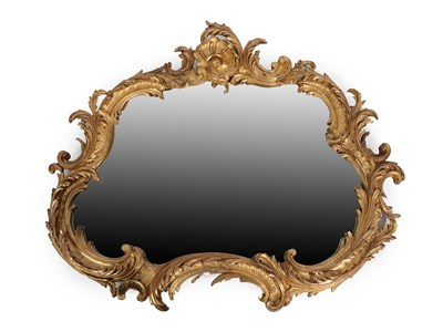 Lot 68 - A Victorian Carved Giltwood Mirror, mid 19th century, the cartouche shaped bevelled plate within an