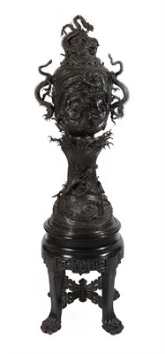 Lot 73 - A Large Japanese Bronze Incense Burner, Cover and Stand, 19th century, of wave moulded baluster...