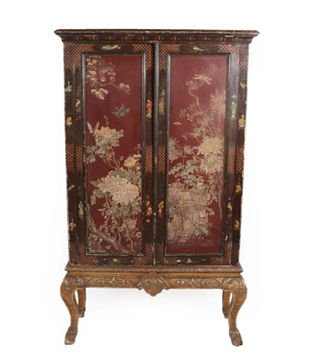 Lot 87 - A Black and Red Chinoiserie Painted Cabinet on Stand, part 18th century, the later moulded...