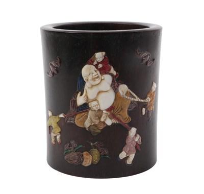 Lot 91 - A Chinese Hardstone Inlaid Hardwood Brush Pot, 19th Century, inlaid with Pu-tai and acolytes,...