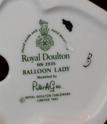 Lot 8 - Two Royal Doulton figures, Balloon Lady HN2935 and Lifeboat Man HN4570