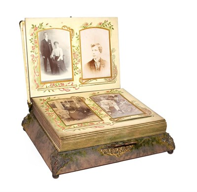 Lot 10 - An Edwardian musical photograph album (empty) mounted in crocodile skin, together with a...