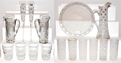 Lot 12 - An Asprey & Garrard part suite of glassware with acid etched marks, including two ewers, large pair