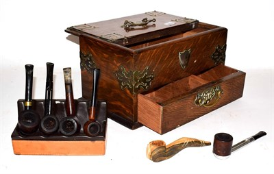 Lot 17 - An early 20th century Smokers cabinet and later pipes