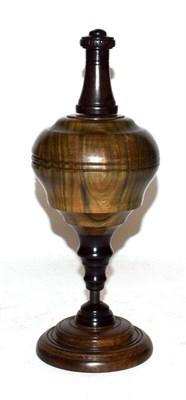 Lot 19 - A lignum vitae and ebony plumb bob on stand, 29.5cm