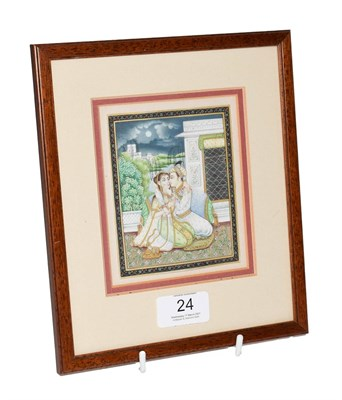 Lot 24 - A 19th century Indian Mughal miniature painting on ivory, courting scene under a moonlit sky, later