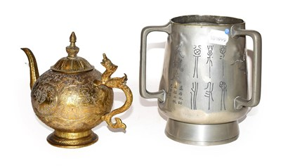 Lot 27 - A Chinese white metal tyg and and a gilt metal teapot (2)