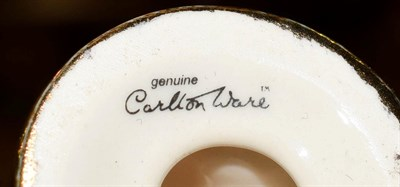 Lot 28 - A collection of eleven Carlton Ware figures together with another figure stamped Trial 16-01-02...
