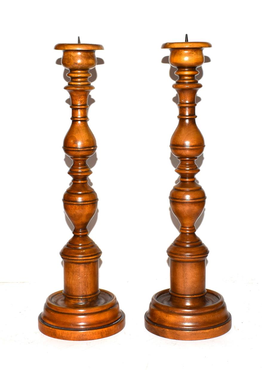 Lot 29 - A pair of modern turned wooden pricket sticks, 43cm high