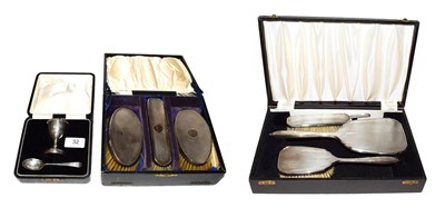 Lot 32 - Two silver-mounted brush sets and a cased silver egg cup and spoon