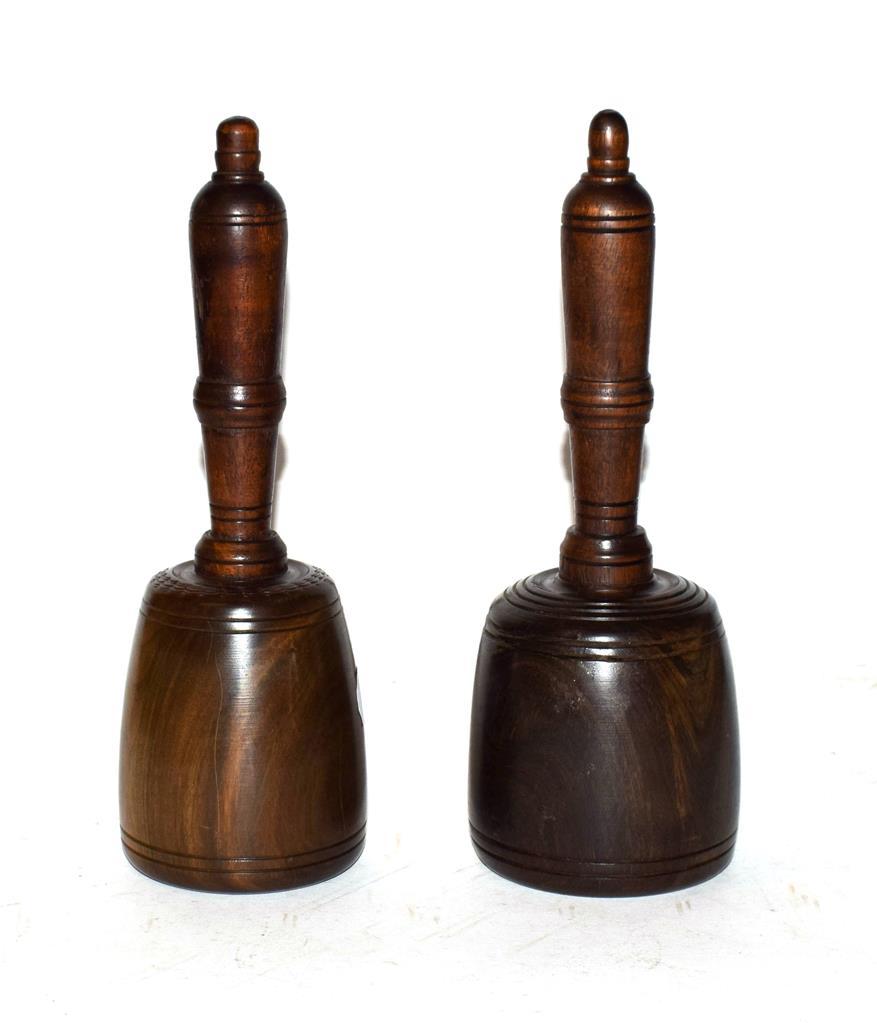 Lot 33 - Two lignum vitae stonemasons mallets with turned mahogany handles, longest 25cm (2)