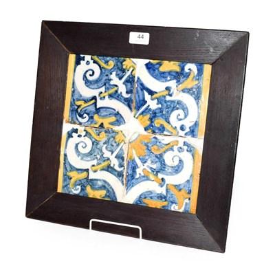 Lot 44 - A framed set of four 17th/18th century polychrome Maiolica tiles, 28cm