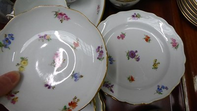 Lot 47 - A quantity of Meissen porcelain tea wares painted with scattered sprigs and three similar tea...