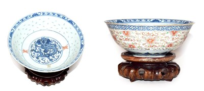 Lot 52 - A Chinese bowl painted in underglaze blue with a dragon and shou characters to the interior and...