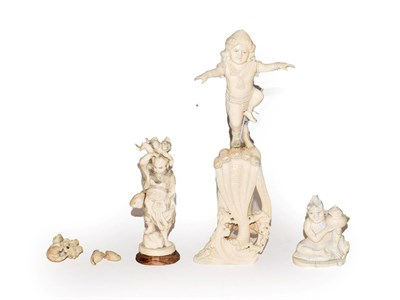 Lot 53 - A quantity of ivory items comprising, a 19th century Indian carved ivory figure of a Deity stood on