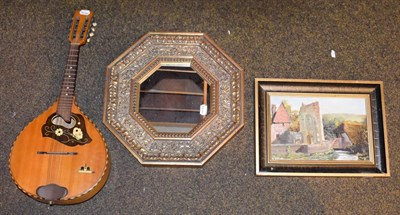 Lot 77 - An inlaid mandolin stamped Musima, oil on board signed C Evison depicting Wilmington Priory and...