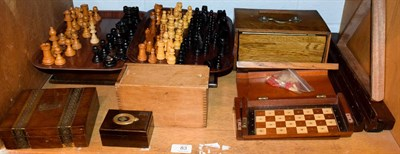 Lot 83 - A quantity of gaming counters and related items including wooden chess pieces, a travelling...