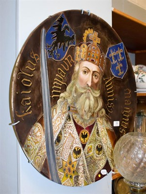 Lot 89 - A large Continental pottery plaque decorated with a central portrait of a King, thought to be...