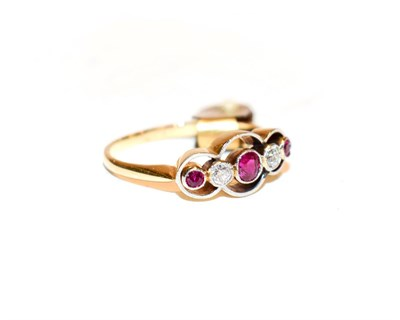 Lot 100 - A synthetic ruby and diamond five stone ring, three graduated round cut rubies alternate with...