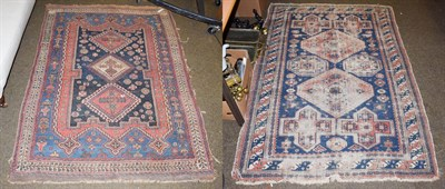 Lot 1075 - An Afshar rug, the indigo field with three medallions framed by ivory borders, 176cm by 127cm,...