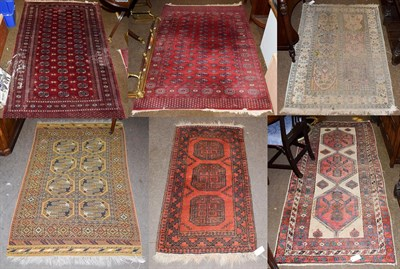 Lot 1077 - An Afghan rug, the crimson field with three rows of guls enclosed by octagon motif borders,...
