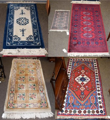 Lot 1081 - A machine made ''Afghan'' rug, the crimson field with five guls, 137cm by 69cm, together with...