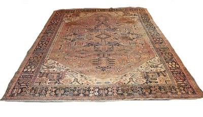 Lot 1085 - Heriz carpet, Iranian Azerbaijan circa 1920. The faded madder field with typical indigo...