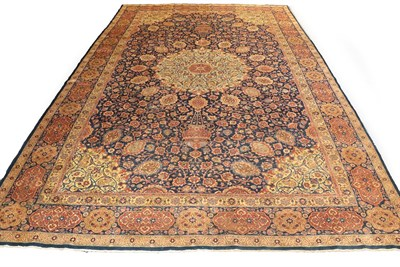 Lot 1086 - Large Tabriz carpet, north west Iran, the indigo field of vines around an ivory roundel...