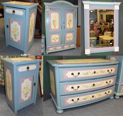 Lot 1090 - A painted pine five piece bedroom suite in blue and lilac decorated with flowers, comprising a...