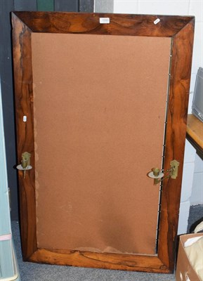 Lot 1093 - A rectangular rosewood mirror frame fitted with twin adjustable sconces, 73cm by 119cm