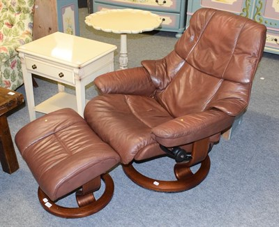 Lot 1094 - An Ekornes Stressless brown leather armchair and footstool