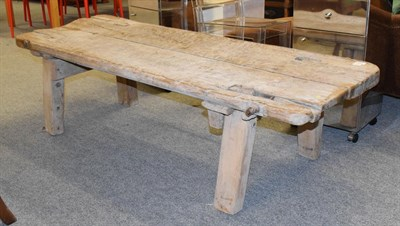 Lot 1098 - A 19th century elm pig bench, 168cm by 64cm by 45cm