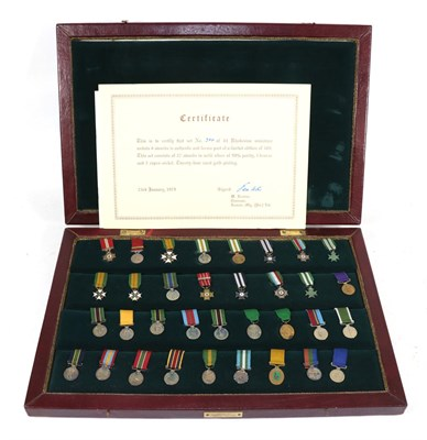 Lot 6 - A Commemorative Set of Thirty Four Rhodesian Miniature Medals and Awards, twenty seven in solid...