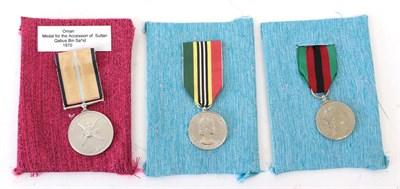 Lot 13 - Oman Accession Medal, Sultan Qaboos bin Said, 1970, with original ribbon; two Commonwealth...