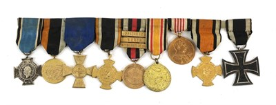 Lot 34 - A First World War Iron Cross, second class, magnetic, the suspender ring maker marked 100; a...