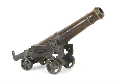 Lot 49A - An 18th/19th Century Bronze Signalling Cannon, the 32cm ringed barrel with ogee muzzle, capstan...