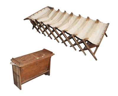 Lot 62 - An Early 20th Century Oak Campaign Bed, with a hinged rectangular top rising to form the...