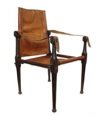 Lot 65 - An Early 20th Century ''Roorkhee'' Campaign Chair, the turned oak frame with conical terminals...