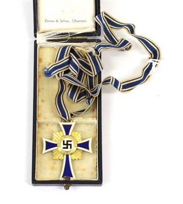 Lot 90 - A German Third Reich Mother's Cross in Gold, in blue leather cloth case, the interior marked Zimmer