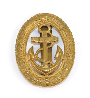 Lot 95 - A German Third Reich Kriegsmarine Officer of the Watch Badge, in stamped gilt metal, with...