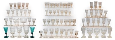 Lot 23 - A quantity of Georgian and later drinking glasses, most with knopped stems, some with etched...