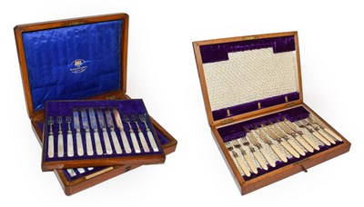 Lot 28 - An Edwardian oak cased set of silver and mother of pearl dessert knives and forks by Goldsmiths...