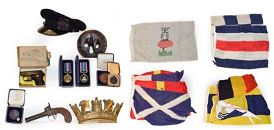 Lot 35 - A merchant naval cap and gilt brass plaque, various signalling flags, rigging block, a 19th century