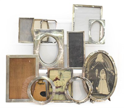 Lot 36 - A George V silver mounted photograph frame with oval aperture and decorated with engine turned...