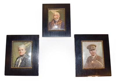 Lot 43 - Three early 20th century ivory portrait miniatures in ebonised easel frames, depicting John...