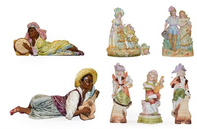 Lot 48 - A pair of Goldschieder style figures of reclining Caribbean musicians (a.f.) together with a...