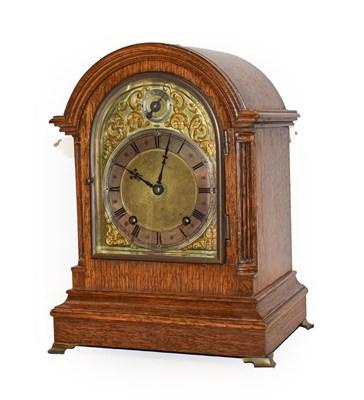 Lot 50 - An oak striking mantel clock, early 20th century, movement backplate stamped W & H Sch, striking on
