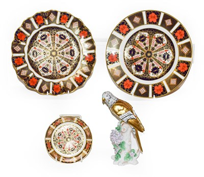 Lot 60 - Two royal Crown Derby plates and a pin dish in the Imari pattern 1128, largest 21.5cm diameter (all