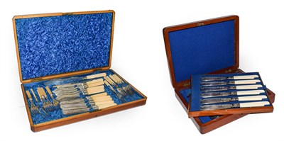 Lot 62 - A Victorian mahogany canteen of ivory handled silver plated cutlery comprising, a pair of fish...